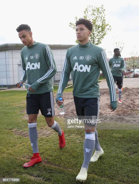 Millen Baars and Nishan Burkart of Manchester United U18s in action during an U18s training session at Aon Training Complex on May 2 2018 in...