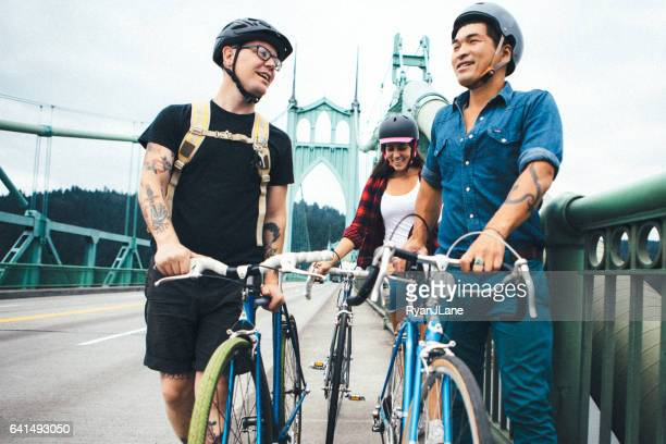 millenial bike riders in urban setting - portland oregon stock photos and pictures