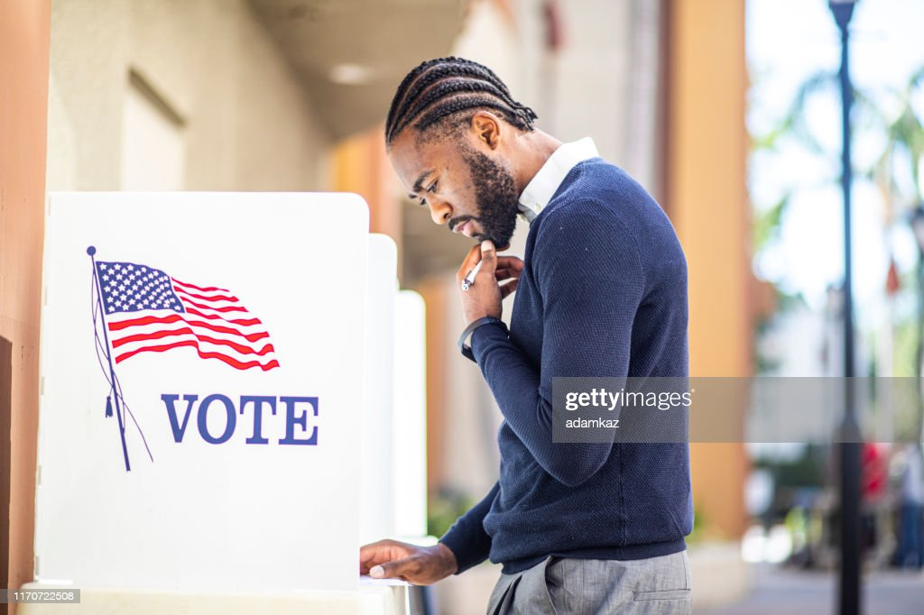 Millenial Black Man Voting in Election : Stock Photo