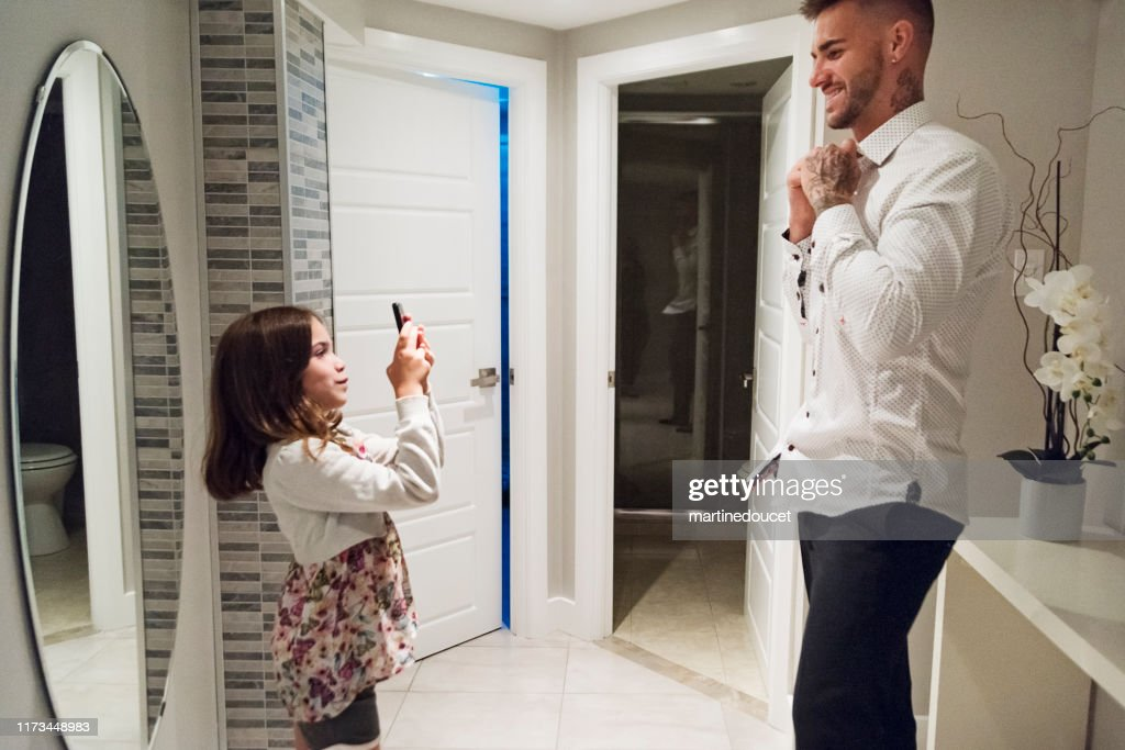 Millenial father getting ready for his wedding. : Stock Photo