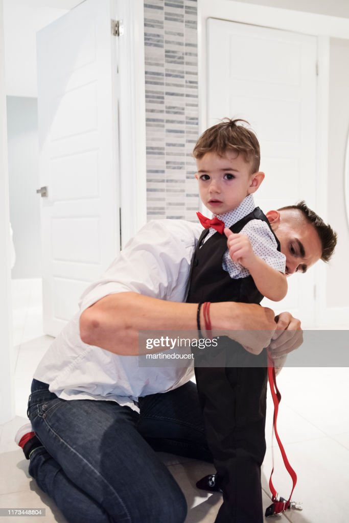 Millenial man with son getting ready for his wedding. : Stock Photo