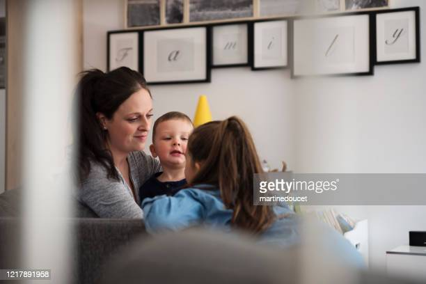 """millenial mother with young children at home. - """"martine doucet"""" or martinedoucet stock pictures, royalty-free photos & images"""