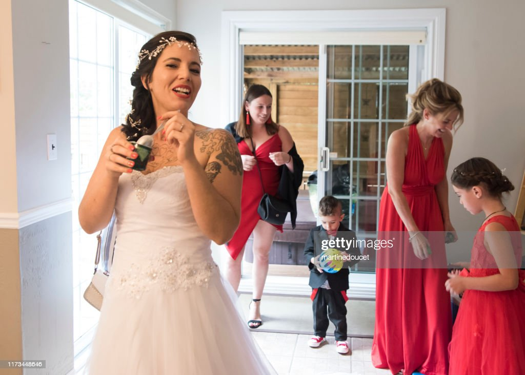 Millenial woman and family getting ready for her wedding. : Stock Photo