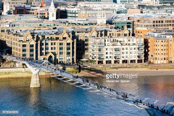 millenium bridge and thames river on a sunny day, london, england, uk - footbridge stock photos and pictures