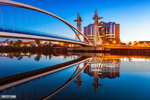 millenium bridge in manchester england uk millenium bridge - manchester uk stock photos and pictures