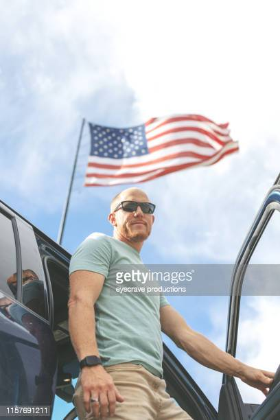 Millennial Adult Male Successful Patriotic Businessman with American Flag in Background