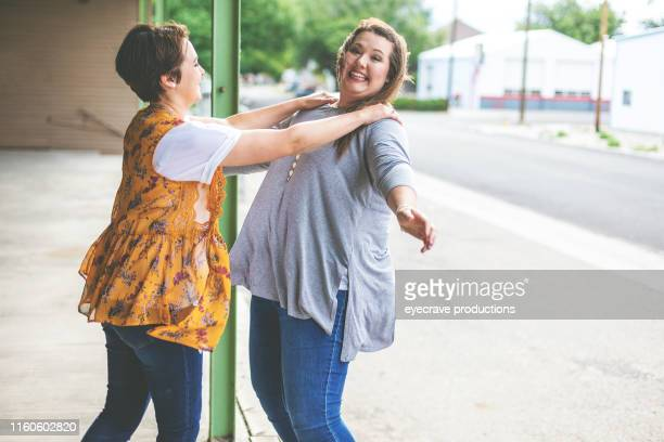 Millennial Adult Sisters enjoying time together in urban setting