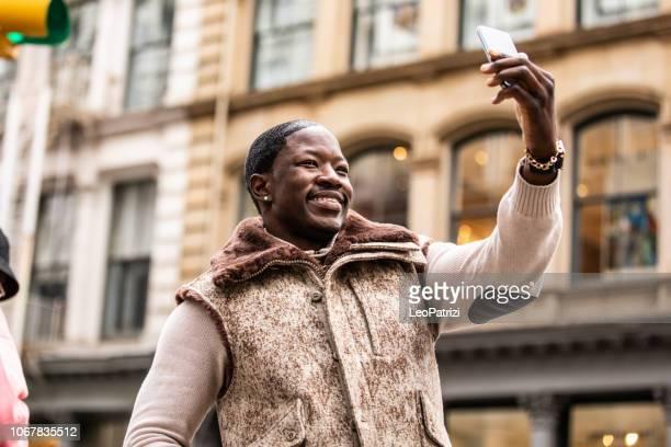Millennial afro american man in Soho New York City