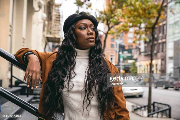 Millennial afro american young woman in Soho New York City