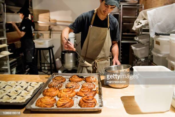 """millennial assistant bread maker in morning routine. - """"martine doucet"""" or martinedoucet stock pictures, royalty-free photos & images"""