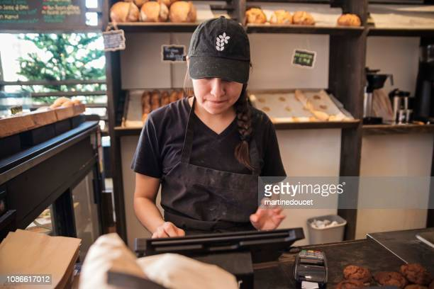 """millennial bread maker happy to sell freshly made bread. - """"martine doucet"""" or martinedoucet stock pictures, royalty-free photos & images"""