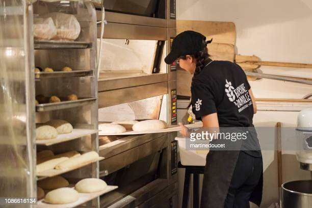 """millennial bread maker in morning routine. - """"martine doucet"""" or martinedoucet stock pictures, royalty-free photos & images"""