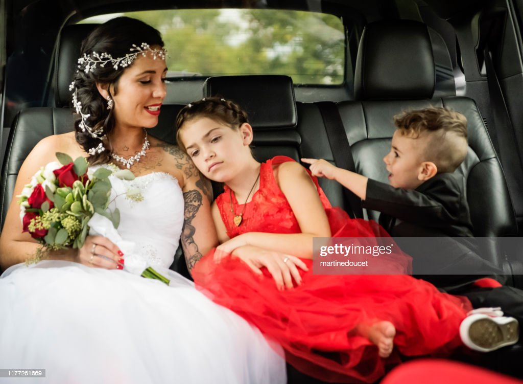 Millennial bride in limousine on her way to wedding. : Stock Photo
