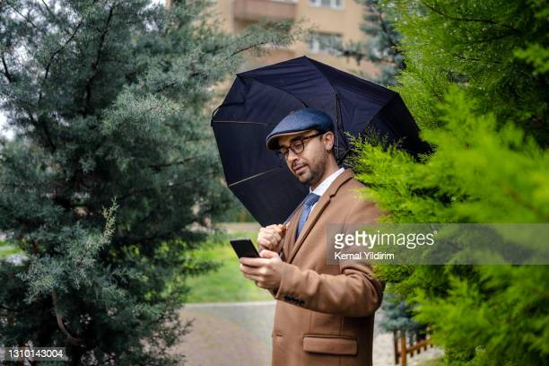 millennial business man texting message to his friend at coffee break - world sports championship stock pictures, royalty-free photos & images