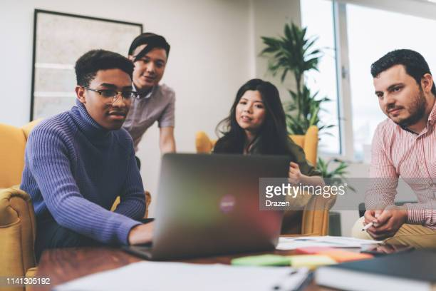millennial business  people using internet for investment opportunities. - debate stock pictures, royalty-free photos & images