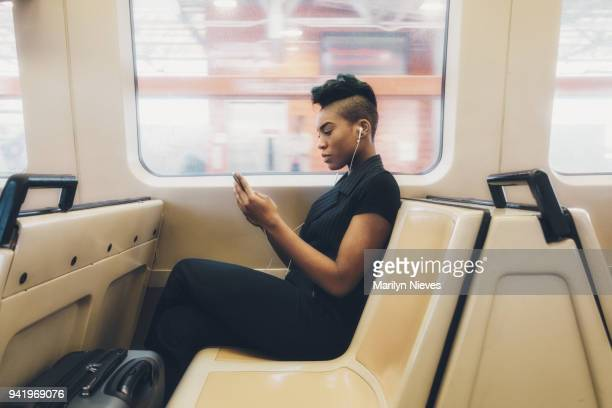 """millennial businesswoman texting - """"marilyn nieves"""" stock pictures, royalty-free photos & images"""