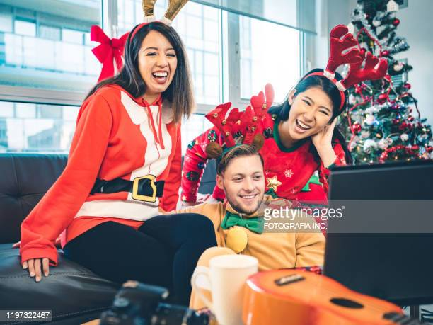 millennial christmas party - ugly christmas sweater party stock pictures, royalty-free photos & images