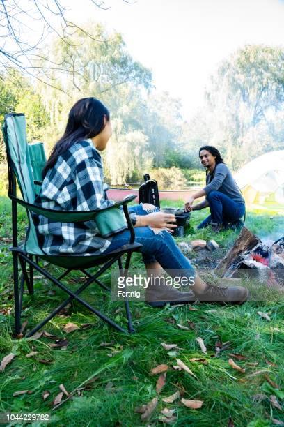 A millennial couple enjoying a camping trip