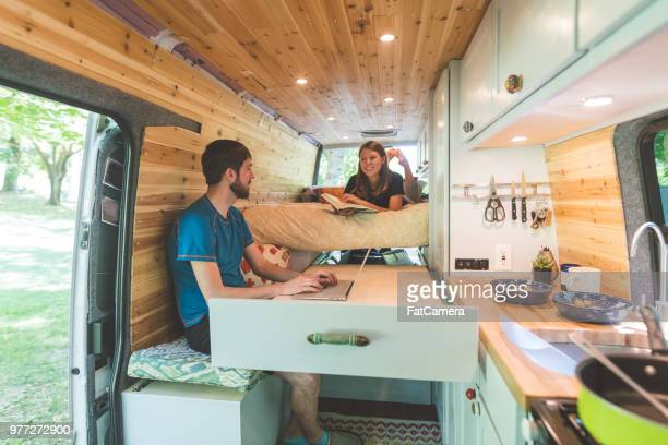 millennial couple living in a van - mini van stock photos and pictures