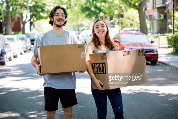 Millennial couple moving in new apartment.