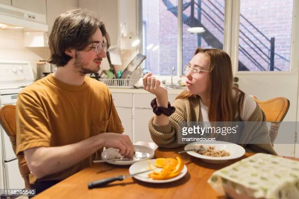 "millennial couple of students shared living at breakfast. - ""martine doucet"" or martinedoucet stock pictures, royalty-free photos & images"
