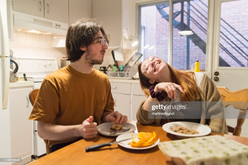 Millennial couple of students shared living at breakfast. : Stock Photo