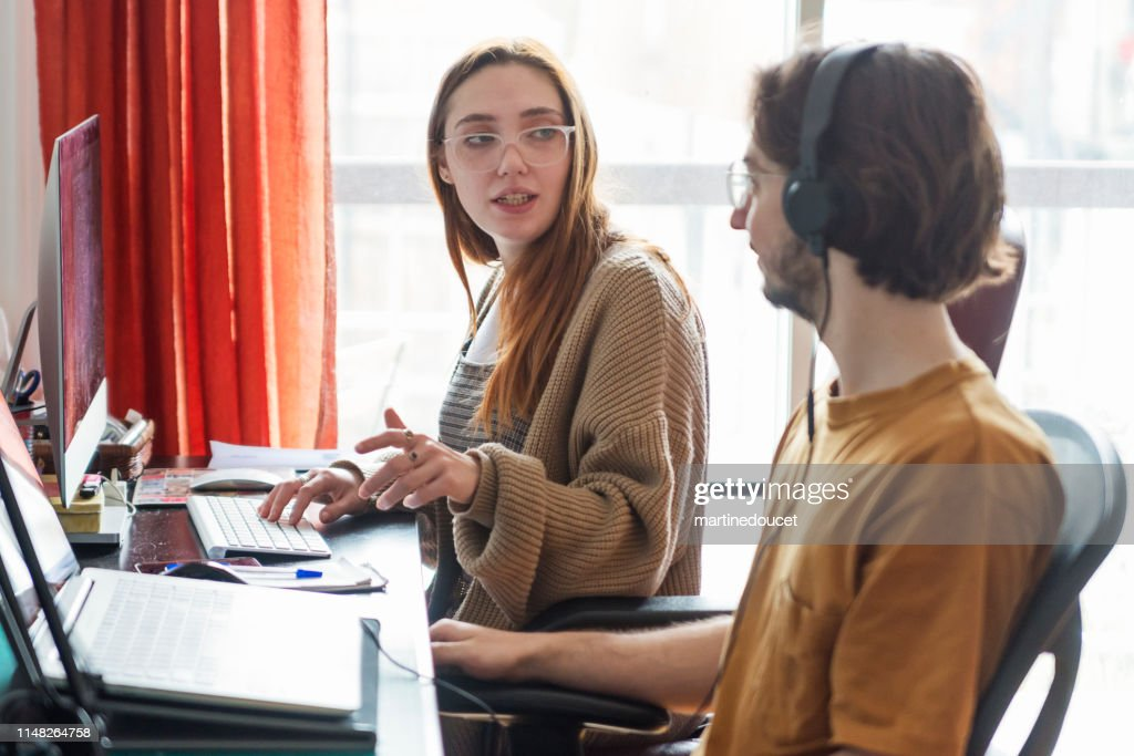 Millennial couple of students working at home. : Stock Photo