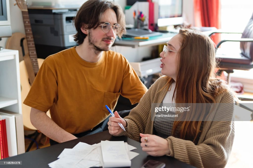 Millennial couple trying to balance monthly budget. : Stock Photo