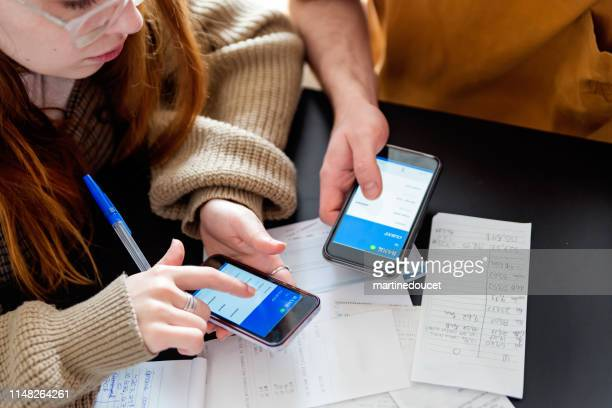 "millennial couple using digital payment to share expense. - ""martine doucet"" or martinedoucet stock pictures, royalty-free photos & images"