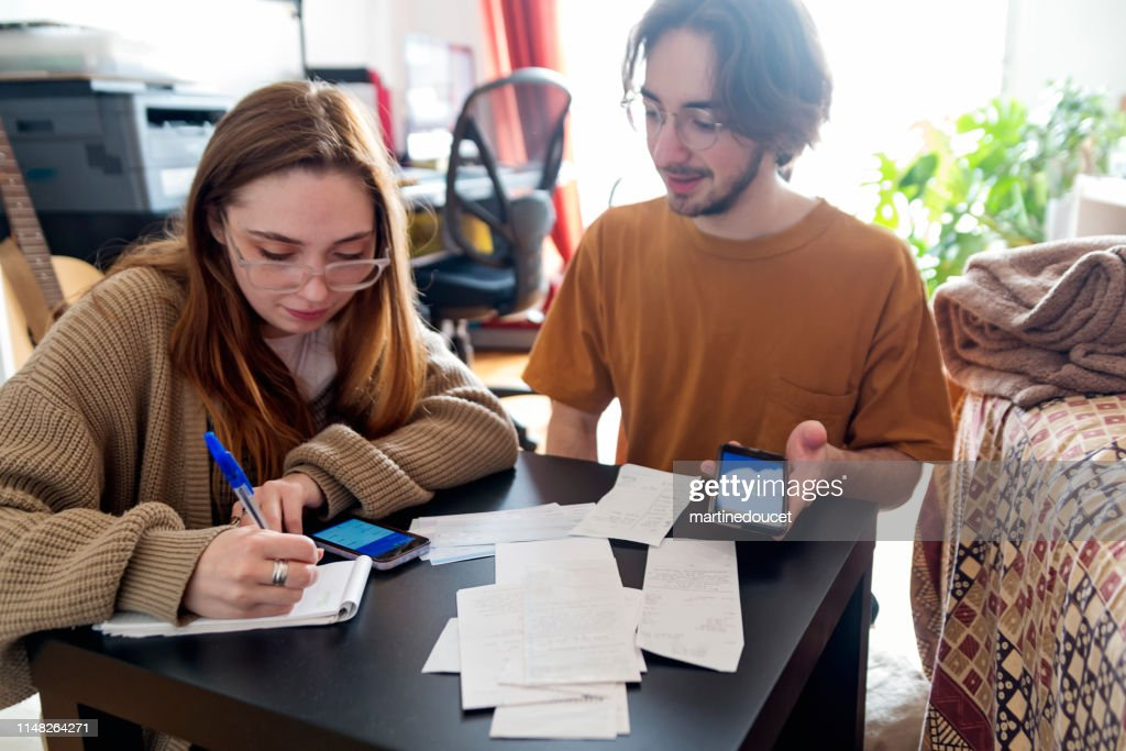Millennial couple using digital payment to share expense. : Stock Photo