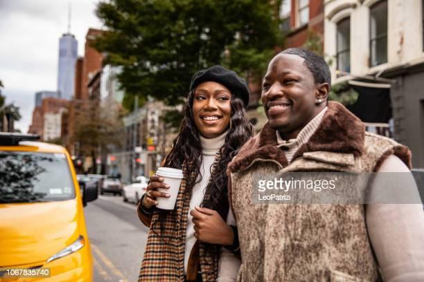 Millennial couple walking in Soho - New York