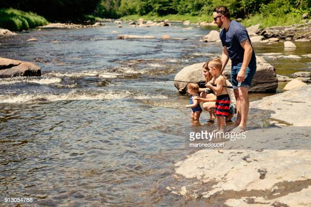 """millennial family bathing in a river in summer nature. - """"martine doucet"""" or martinedoucet stock pictures, royalty-free photos & images"""