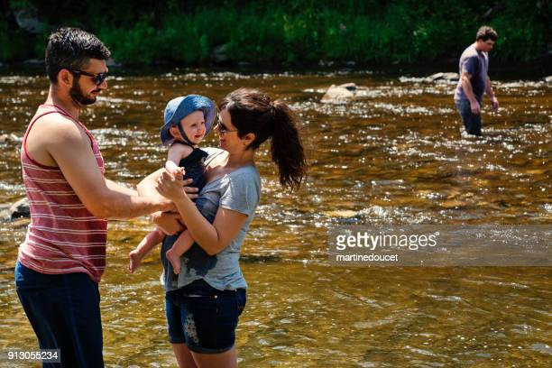 "millennial family bathing in a river in summer nature. - ""martine doucet"" or martinedoucet stock pictures, royalty-free photos & images"