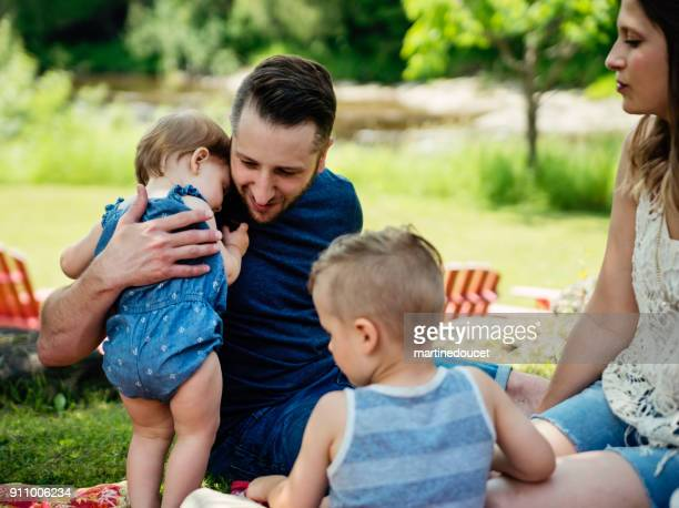 """millennial family having a picnic outdoors in summer. - """"martine doucet"""" or martinedoucet stock pictures, royalty-free photos & images"""