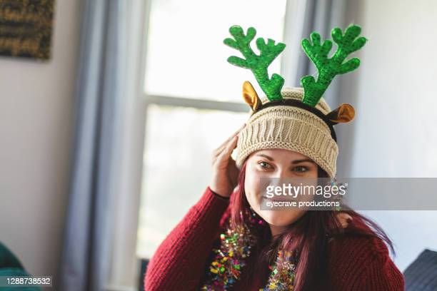 millennial female getting ready for christmas holidays photo series with matching video - eyecrave  stock pictures, royalty-free photos & images
