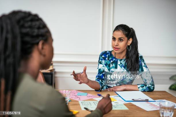 millennial financial advisor talking to client. indian leader in business. - skill stock pictures, royalty-free photos & images