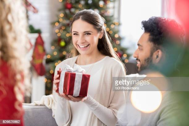Millennial friends exchange gifts at Christmas
