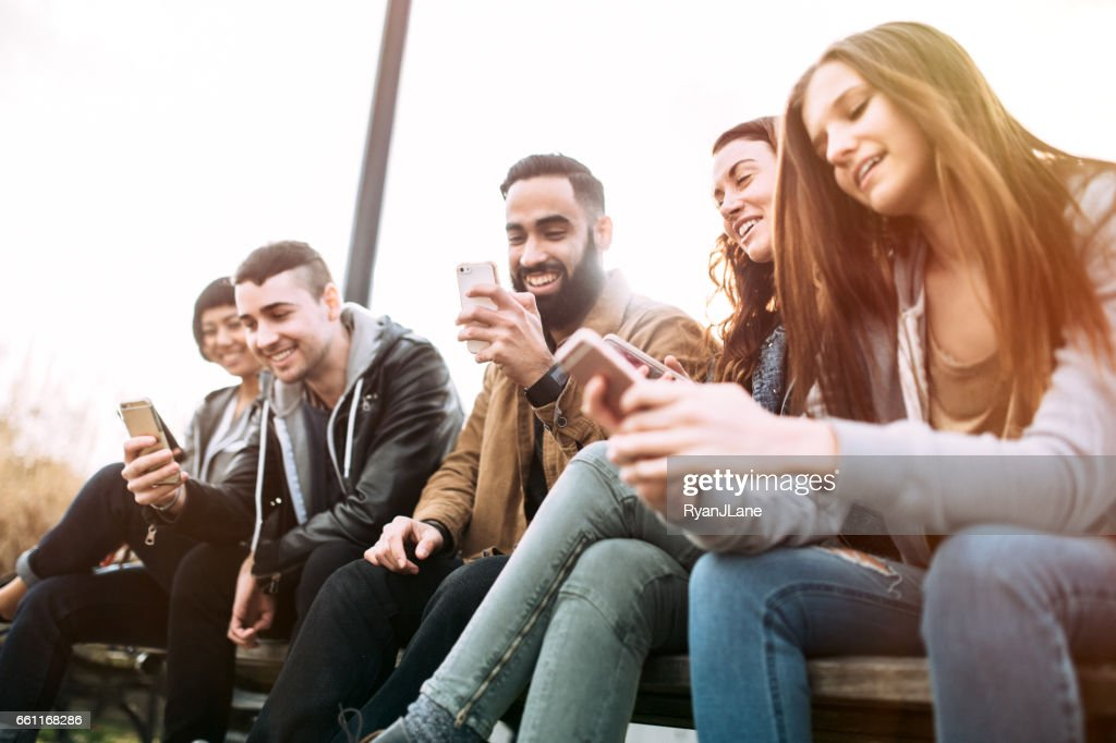 Millennial Friends on Smart Phones : Stock Photo