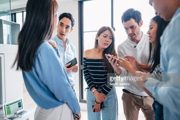 Millennial friends watching mobile phones