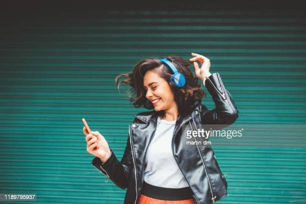 millennial girl enjoying disco music - leather jacket stock pictures, royalty-free photos & images