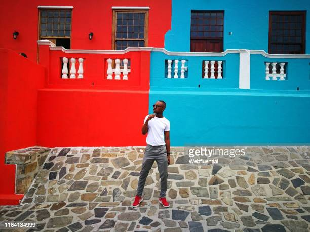 millennial in bo-kaap - webfluential stock pictures, royalty-free photos & images