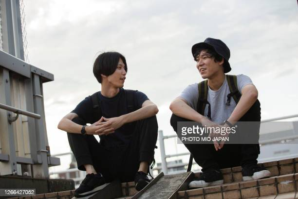 millennial men who are living in the suburban city in japan - japan stock pictures, royalty-free photos & images
