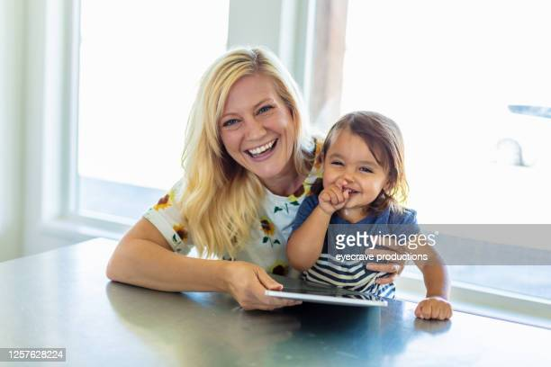 millennial mother spending time with her adopted toddler son - eyecrave  stock pictures, royalty-free photos & images