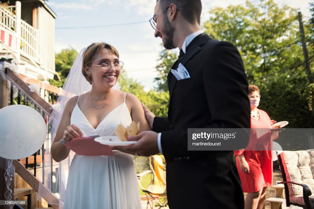 Millennial newlywed couple at wedding cocktail in backyard. : Stock Photo
