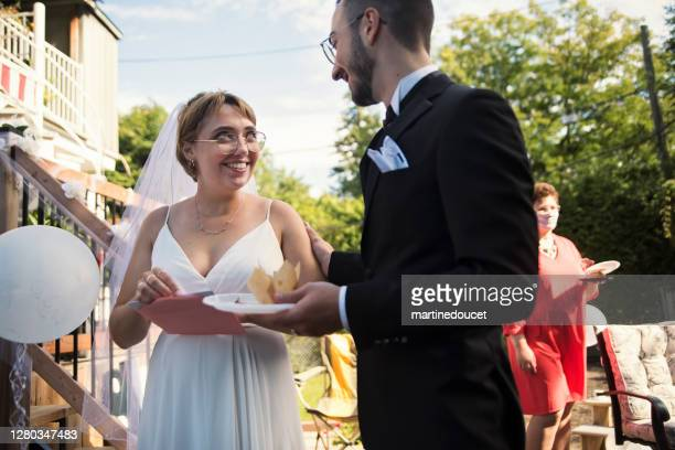 """millennial newlywed couple at wedding cocktail in backyard. - """"martine doucet"""" or martinedoucet stock pictures, royalty-free photos & images"""