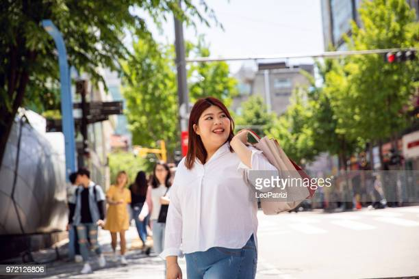 millennial out for shopping in seoul - south korea - fat asian woman stock pictures, royalty-free photos & images