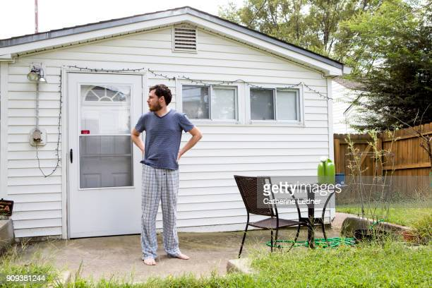 millennial outside small house - pajamas stock pictures, royalty-free photos & images