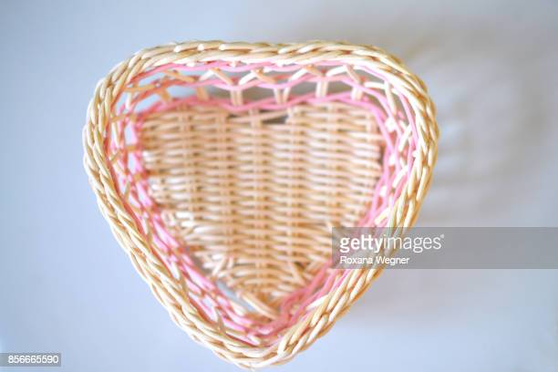 millennial pink and white heart shape basket - millennial pink stock pictures, royalty-free photos & images