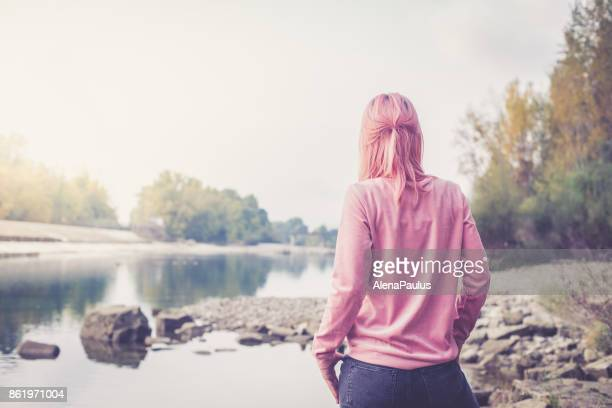 millennial pink young woman - pink pants stock pictures, royalty-free photos & images