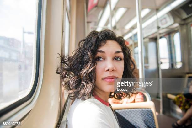 Millennial Puerto Rican Woman Traveling Public Transportation in Chicago Illinois